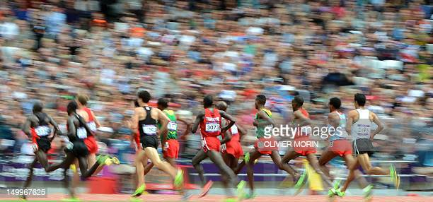 Athletes compete in the men's 5000m heats at the athletics event of the London 2012 Olympic Games on August 8 2012 in London AFP PHOTO / OLIVIER MORIN