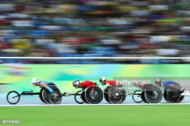 Athletes compete in the Men's 5000m T54 heat on day 2 of the Rio 2016 Paralympic Games at Olympic Stadium on September 9 2016 in Rio de Janeiro Brazil