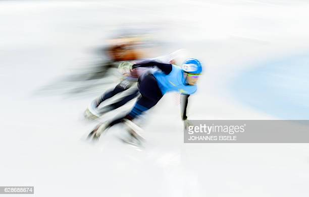 TOPSHOT Athletes compete in the men's 500m qualifying at the ISU World Cup Short Track speed skating event in Shanghai December 9 2016 / AFP /...