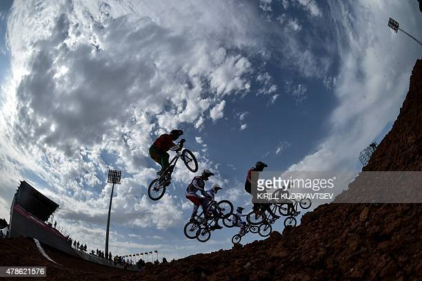 Athletes compete in the men's cycling BMX motos race at the 2015 European Games in Baku on June 26 2015 AFP PHOTO / KIRILL KUDRYAVTSEV