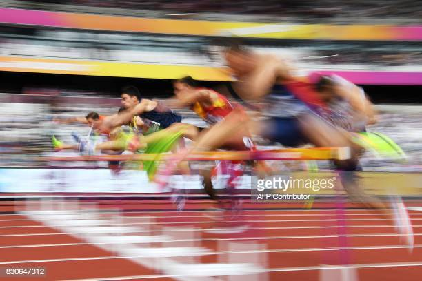 TOPSHOT Athletes compete in the men's decathlon 110m hurdles athletics event at the 2017 IAAF World Championships at the London Stadium in London on...