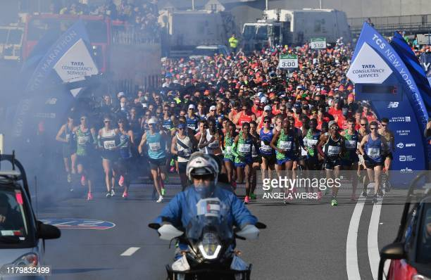 Athletes compete in the Men's Division during the 2019 TCS New York City Marathon on November 3 2019 Geoffrey Kamworor and Joyciline Jepkosgei sealed...