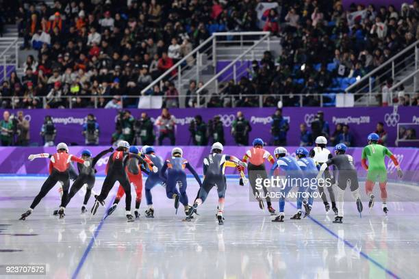 TOPSHOT Athletes compete in the men's mass start final speed skating event during the Pyeongchang 2018 Winter Olympic Games at the Gangneung Oval in...