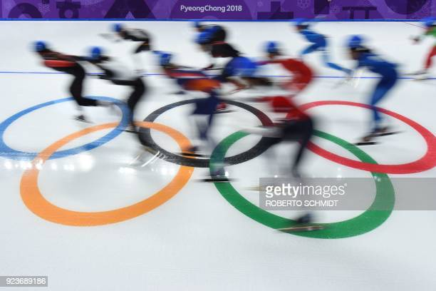 TOPSHOT Athletes compete in the men's mass start semifinal speed skating event during the Pyeongchang 2018 Winter Olympic Games at the Gangneung Oval...