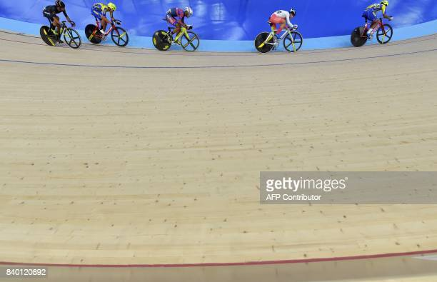 Athletes compete in the men's omnium cycling qualification at the 29th Southeast Asian Games in Nilai on August 28, 2017. / AFP PHOTO / Adek BERRY /...