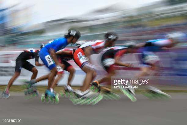 Athletes compete in the men's roller skate road 20km race final during the 2018 Asian Games in Palembang on August 31 2018