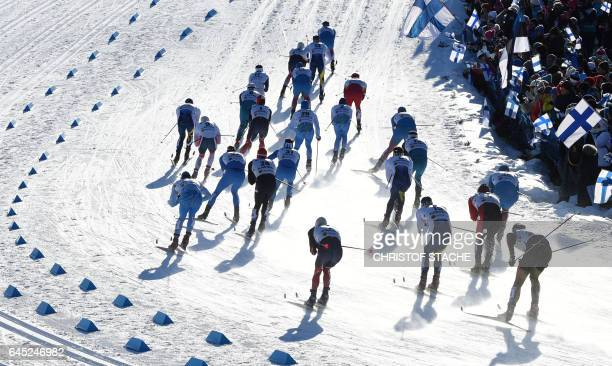 Athletes compete in the men's Skiathlon event of the 2017 FIS Nordic World Ski Championships in Lahti, Finland, on February 25, 2017. / AFP /...