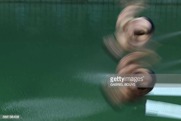 TOPSHOT Athletes compete in the Men's Synchronised 3m Springboard Final during the diving event at the Rio 2016 Olympic Games at the Maria Lenk...