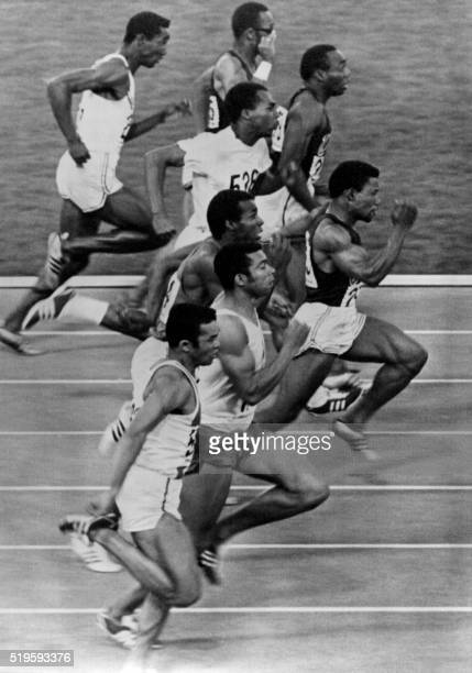 Athletes compete in the Olympics men's 100m final on October 14 1968 in Mexico City at the Mexico Olympic Games Athletes are French Roger Bambuck US...