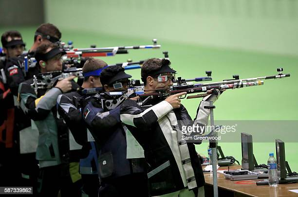 Athletes compete in the qualifying portion of the 10m Air Rifle event on Day 3 of the Rio 2016 Olympic Games at the Olympic Shooting Centre on August...