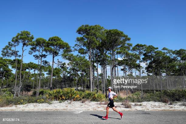 Athletes compete in the run portion of the IRONMAN Florida competition on November 4 2017 in Panama City Beach Florida