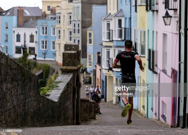 Athletes compete in the run section during Ironman Wales on September 15, 2019 in Tenby, Wales.