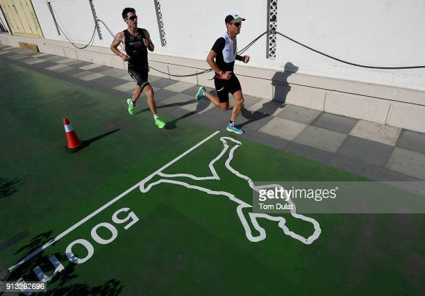 Athletes compete in the run section during the Ironman 703 Dubai 2018 on February 2 2018 in Dubai United Arab Emirates