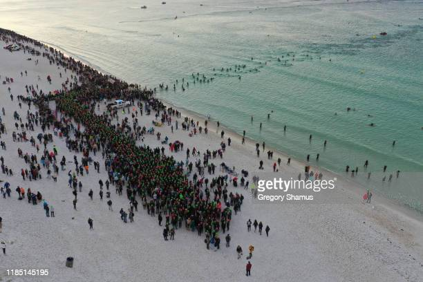 Athletes compete in the swim leg at the Ironman Florida on November 02 2019 in Panama City Florida