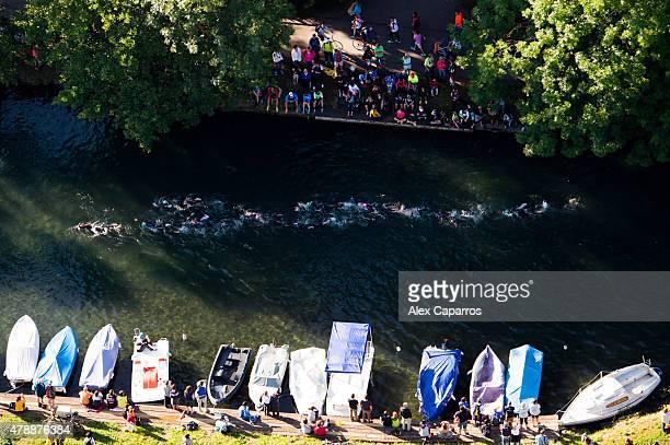 Athletes compete in the swim leg of the race during Ironman Klagenfurt on June 28 2015 in Klagenfurt Austria
