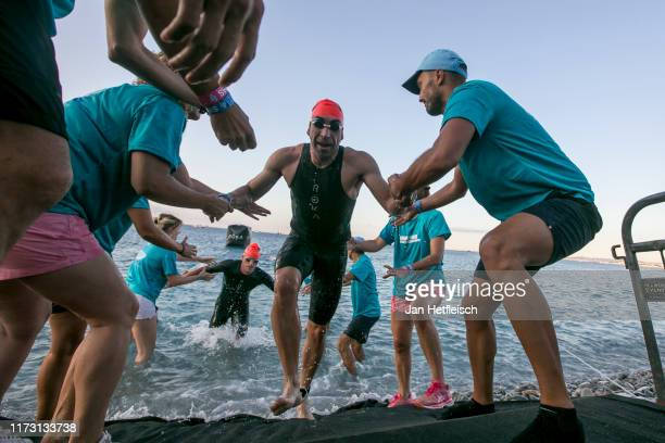 Athletes compete in the swim leg of the the IRONMAN 703 World Championship Men in Nice on September 08 2019 in Nice France
