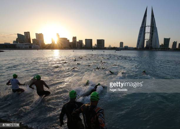 Athletes compete in the swim section of the Ironman 703 Middle East Championship Bahrain on November 25 2017 in Bahrain Bahrain