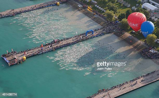 Athletes compete in the swimming leg of Ironman Austria at Worthersee Lake on June 29 2014 in Klagenfurt Austria