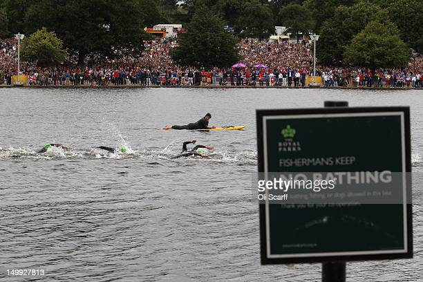 Athletes compete in the swimming stage of the Men's Triathlon event at the London 2012 Olympic Games in Hyde Park on August 7 2012 in London England