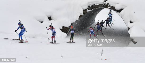 Athletes compete in the women's 10 km pursuit event at the IBU World Cup Biathlon in Hochfilzen Austria on December 9 2017 / AFP PHOTO / JOE KLAMAR