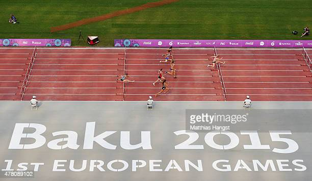 Athletes compete in the Women's 100 metres hurdles during day ten of the Baku 2015 European Games at the Olympic Stadium on June 22 2015 in Baku...