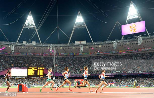 Athletes compete in the women's 10000m final at the athletics event during the London 2012 Olympic Games on August 3 2012 in London AFP PHOTO / ERIC...