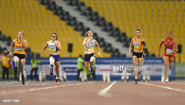Athletes compete in the women's 100m T44 final during the Evening Session on Day Eight of the IPC Athletics World Championships at Suhaim Bin Hamad...