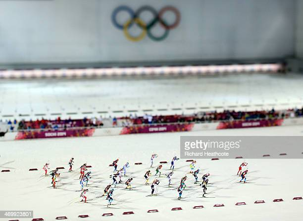 Athletes compete in the Women's 12.5 km Mass Start during day ten of the Sochi 2014 Winter Olympics at Laura Cross-country Ski & Biathlon Center on...