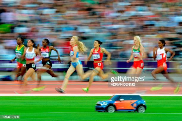 Athletes compete in the women's 1500m semifinals at the athletics event of the London 2012 Olympic Games on August 8 2012 in London AFP PHOTO /...