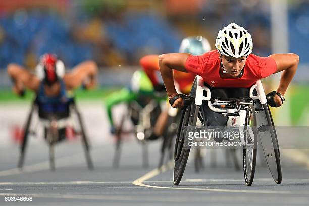 Athletes compete in the women's 1500m wheelchair race at the Olympic Stadium during the Paralympic Games in Rio de Janeiro Brazil on September 12...