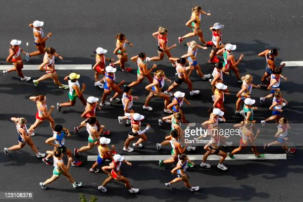 Athletes compete in the women's 20km race walk during day five of the 13th IAAF World Athletics Championships in Daegu city centre on August 31, 2011...