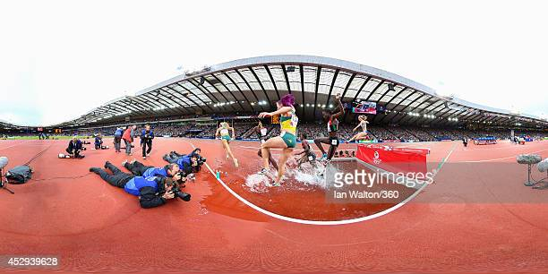 Athletes compete in the Women's 3000 metres Steeplechase at Hampden Park during day seven of the Glasgow 2014 Commonwealth Games on July 30, 2014 in...