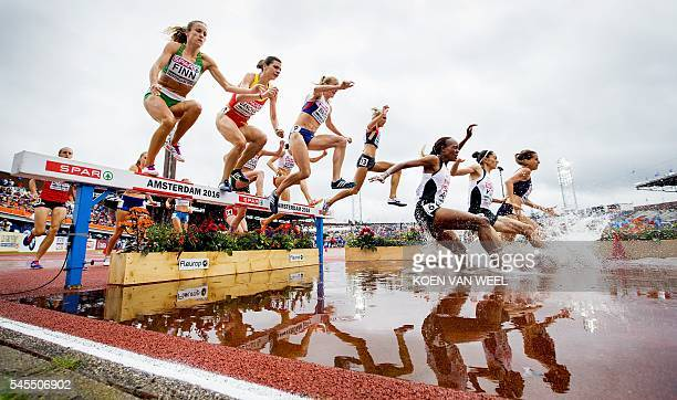 TOPSHOT Athletes compete in the women's 3000m Steeplechase Qualifying Rounds at the European Athletics Championships in the Olympic Stadium in...