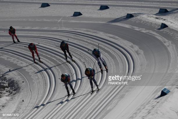 TOPSHOT Athletes compete in the women's 30km cross country mass start classic at the Alpensia cross country ski centre during the Pyeongchang 2018...