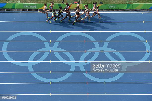 TOPSHOT Athletes compete in the Women's 5000m Round 1 during the athletics event at the Rio 2016 Olympic Games at the Olympic Stadium in Rio de...