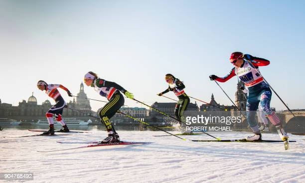 Athletes compete in the women's 6 x 13 km team sprint race during the FIS CrossCountry World Cup in Dresden eastern Germany on January 14 2018 / AFP...