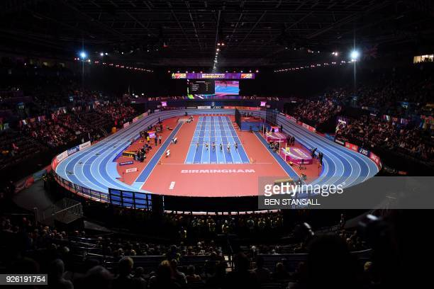 Athletes compete in the women's 60m hurdles pentathlon event at the 2018 IAAF World Indoor Athletics Championships at the Arena in Birmingham on...