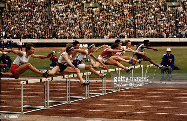 Athletes compete in the Women's 80m Hurdle Final during the Tokyo Olympic at the National Stadium on October 14 1964 in Tokyo Japan
