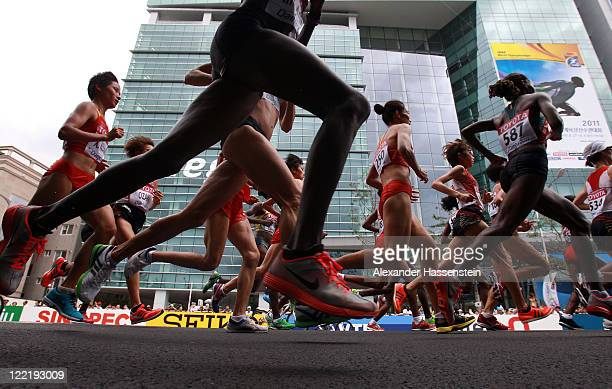 Athletes compete in the women's marathon during day one of 13th IAAF World Athletics Championships at the Daegu Stadium on August 27, 2011 in Daegu,...