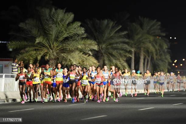 Athletes compete in the Women's Marathon during day one of 17th IAAF World Athletics Championships Doha 2019 at Khalifa International Stadium on...