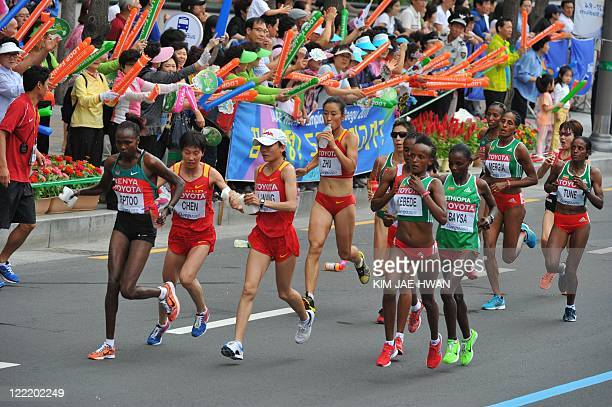 Athletes compete in the women's marathon event at the International Association of Athletics Federations World Championships in Daegu on August 27...