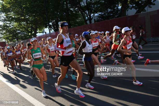 Athletes compete in the women's marathon final during the Tokyo 2020 Olympic Games in Sapporo on August 7, 2021.
