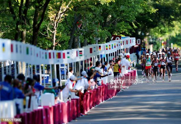 Athletes compete in the Women's Marathon Final on day fifteen of the Tokyo 2020 Olympic Games at Sapporo Odori Park on August 07, 2021 in Sapporo,...