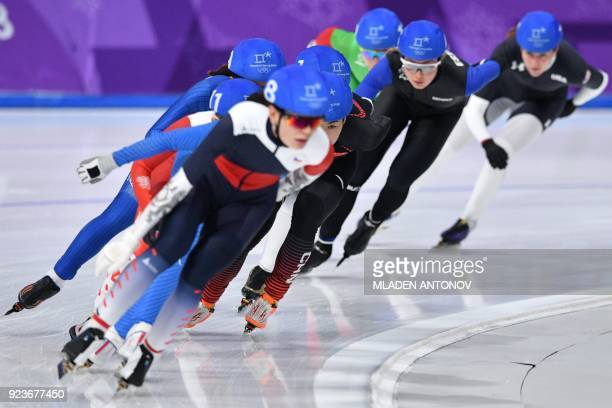 TOPSHOT Athletes compete in the women's mass start semifinal speed skating event during the Pyeongchang 2018 Winter Olympic Games at the Gangneung...