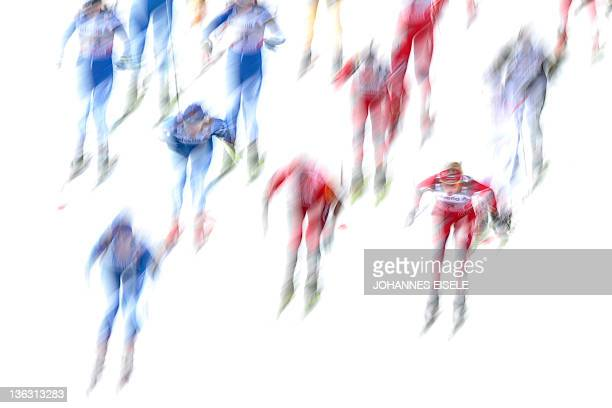 Athletes compete in the women's Tour de Ski skiathlon 5 km Classic 5 km Freestyle event on January 1 2012 in Oberstdorf sourthern Germany Norway's...