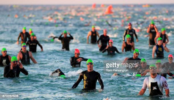 Athletes compete in tthe swim portion of the IRONMAN Florida competition on November 4 2017 in Panama City Beach Florida