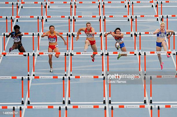 Athletes compete on the Women's 100 metres hurdles Final on day six of the 14th IAAF World Junior Championships at Estadi Olimpic Lluis Companys on...