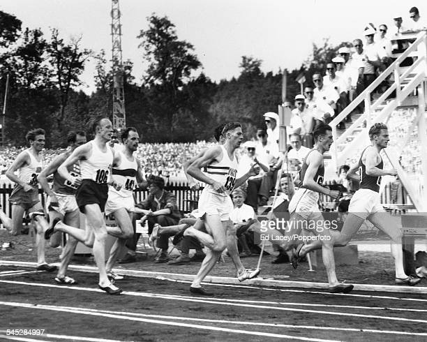 Athletes competing in the 1500m final Stanislav Jungwirth of Czechoslovakia leading followed by Jorma Kakko of Finland Roger Bannister of Great...