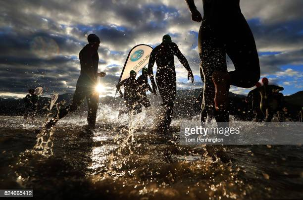 Athletes competing in the Age Group Divisions enter the water during the Subaru Ironman Canada triathlon on July 30 2017 in Whistler Canada