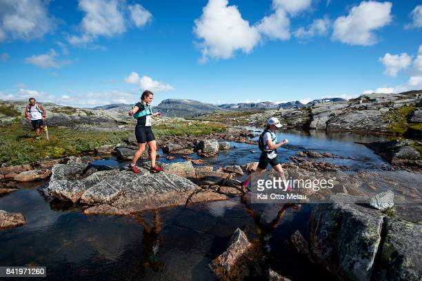 Athletes crossing a river at Hardangervidda Marathon on September 2 2017 in Eidfjord Norway Hardangervidda Marathon goes through parts of the...